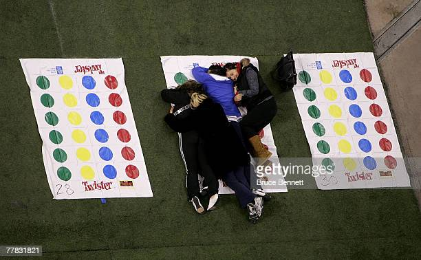 Volunteers relax prior to a failed attempt to break the World Twister record for largest game of 4160 people at the Rogers Centre November 9 2007 in...