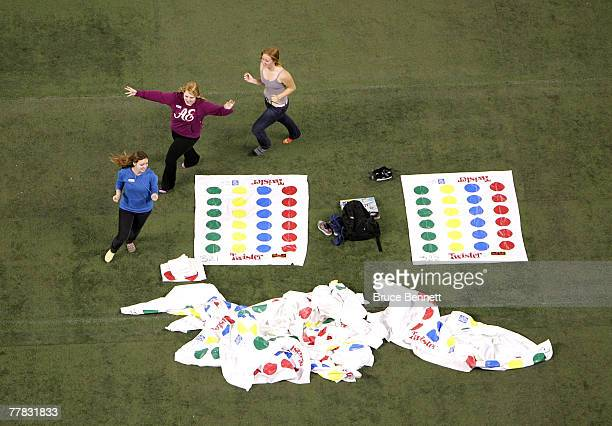 Volunteers run around prior to a failed attempt to break the World Twister record for largest game of 4160 people at the Rogers Centre November 9...