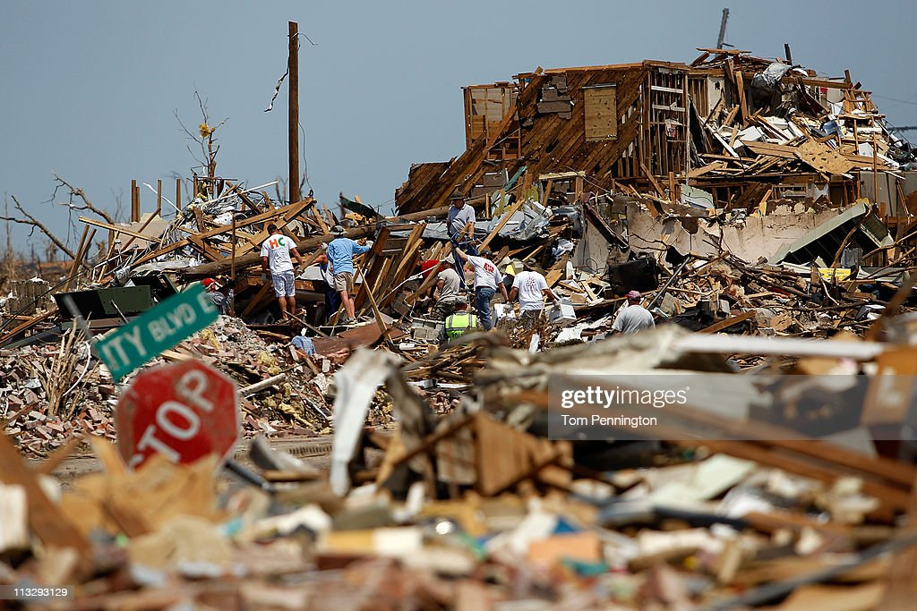 Volunteers search through destroyed homes on April 30, 2011 in Tuscaloosa, Alabama. Alabama, the hardest-hit of six states, is reported to have had nearly 300 deaths as a result of the storms.