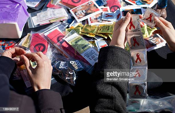 Volunteers separate condoms to give away during a free HIV testing event at by the WhitmanWalker Health February 7 2012 in Washington DC...