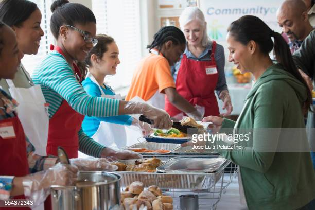 Volunteers serving food at community kitchen