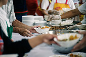 Volunteers Share Food to the Poor to Relieve Hunger: Charity concept