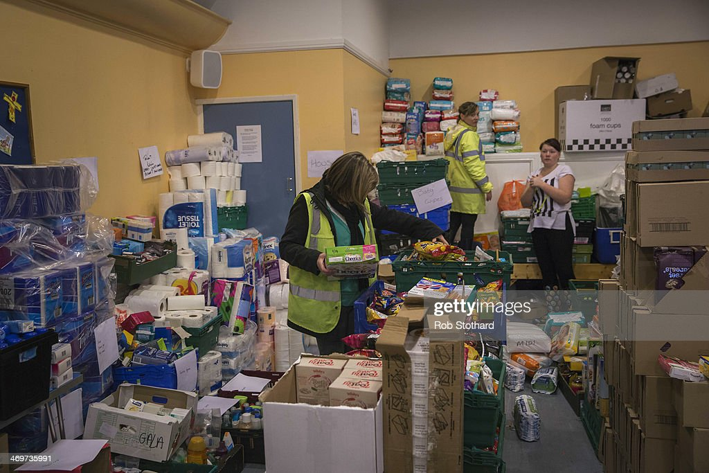Volunteers sort donations of food, toiletries and other items in St Paul's Church Hall on February 16 2014 in Staines, England. Housing near the river Thames has suffered a week of flooding after the river burst it's banks on February 10, 2014.