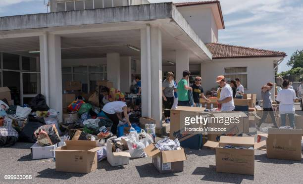 Volunteers sort out clothing at the Santa Casa da Misericordia for the victims of the forest fire on June 22 2017 in Pedrogao Grande Portugal...