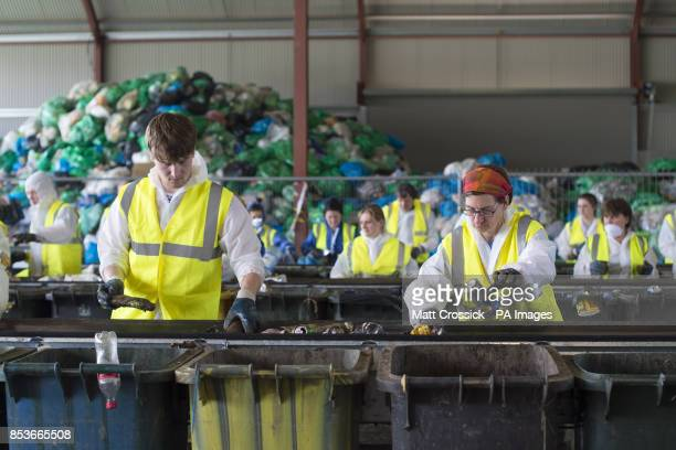 Volunteers sort waste at the recycling centre at the Glastonbury Festival at Worthy Farm in Somerset All waste on site is sorted into recycling...
