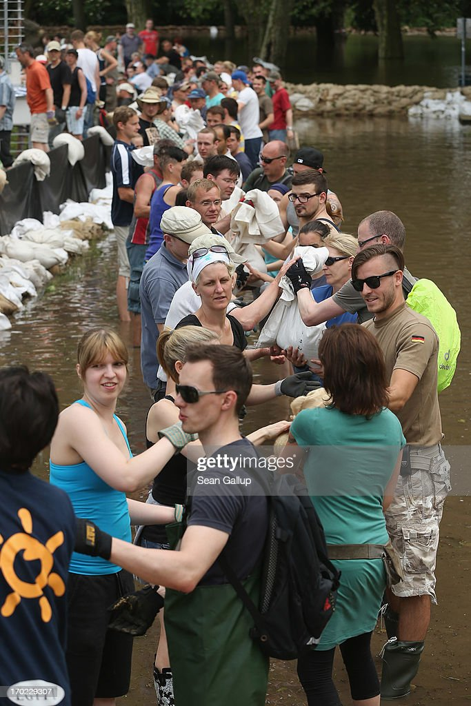 Volunteers stack sandbags against rising floodwaters in the residential Werder district of the city center next to the swollen Elbe river on June 9, 2013 in Magdeburg, Germany. Magdeburg is enduring its highest floodwaters in its 1,200 year history and local authorities have called on 23,000 residents from outlying areas to evacuate their homes. Catastrophic flooding has hit portions of southern and eastern Germany that has left at least seven people dead and forced tens of thousands to flee their homes. Towns in northern Germany downstream from the Elbe are also bracing for floods in coming days.