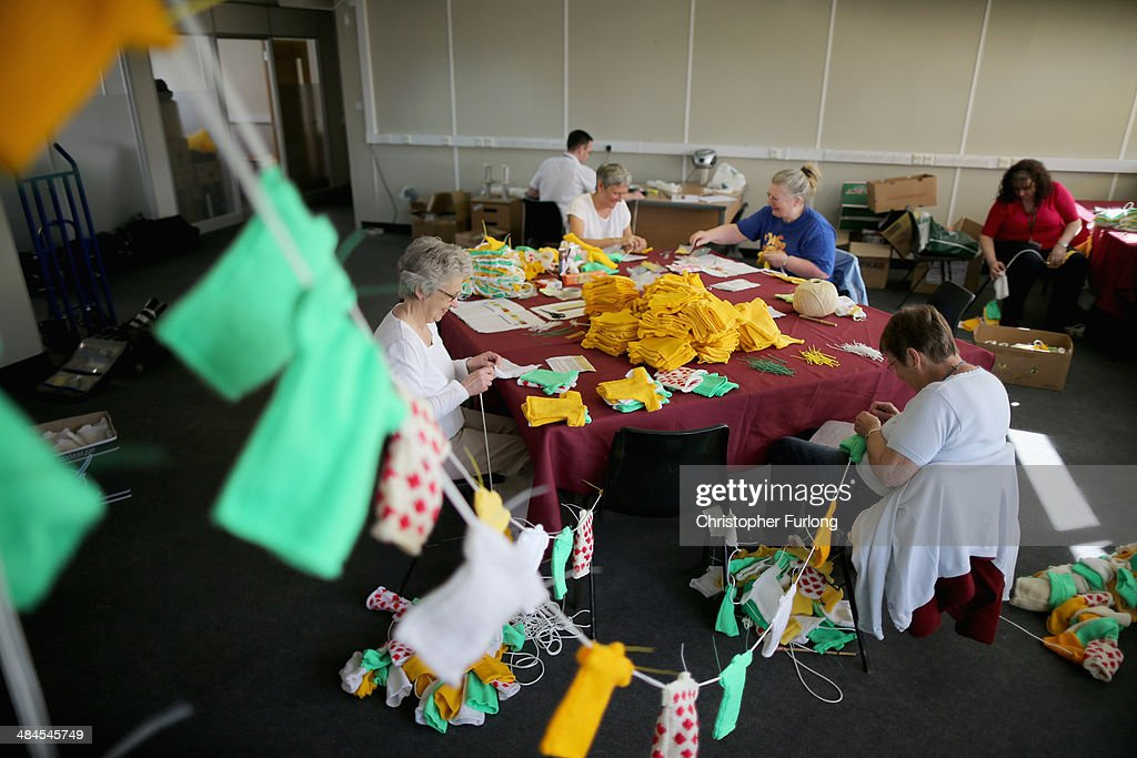 Volunteers string together some of the thousands of hand knitted miniature jerseys that will be used as bunting to decorate the streets and lanes of Harrogate when the Tour de France makes its way through Yorkshire, on April 11, 2014 in Harrogate, England. Over 23000 hand knitted woollen jerseys have been made by volunteers to decorate the route of the Yorkshire Grand Depart of the Tour de France 2014 on July 5th, 2014.