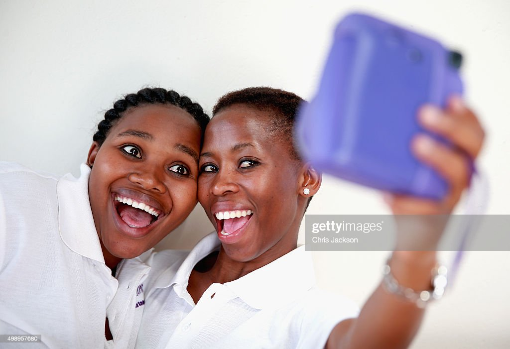 Volunteers take a 'selfie' during some downtime at the Sentebale Mamohato Children's Camp on October 17, 2015 in Maseru, Lesotho. Getty Images have partnered with Prince Harry's Charity Sentebale to help bring photography to some of the vulnerable children of Lesotho. In an ongoing project and with the Support of Fujifilm Getty Images has helped develop and run lessons with children at the new Sentebale Mamohato Children's Centre as a way of helping develop interpersonal, creative and communication skills amongst some of the most disadvantaged children in the world. Sentebale was founded by Prince Harry and Prince Seeiso of Lesotho ten years ago.
