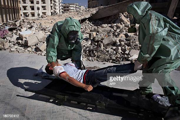 Volunteers take part in a simulation of how to respond to a chemical attack in the northern Syrian city of Aleppo on September 15 2013 For two months...