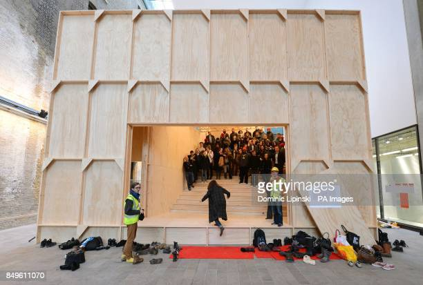 Volunteers take part in a stress test of the installation 'Black Maria' produced by artist Richard Wentworth in collaboration with Swiss architecture...
