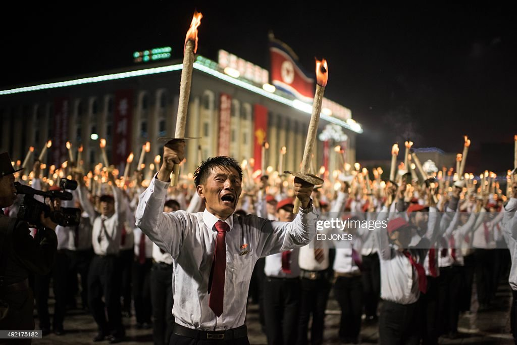 Volunteers take part in a torch-lighting performance at Kim Il-Sung square in Pyongyang on October 10, 2015. North Korea was marking the 70th anniversary of its ruling Workers' Party. AFP PHOTO / Ed Jones