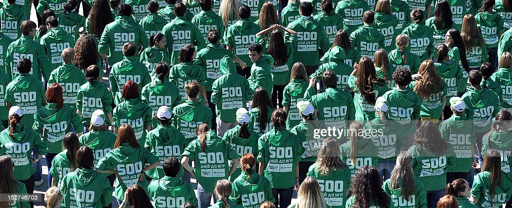 Volunteers take part in flash mob to mark the 500-days before 2014 Winter Olympics in the Russian Black Sea resort of Sochi, on September 25, 2012. The 2014 Winter Olympics will be the biggest international event hosted by Russia since the collapse of the Soviet Union.