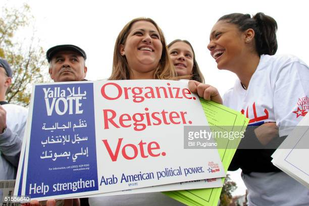 Volunteers take part in the Yalla Vote Walk October 24 2004 in Dearborn Michigan The Yalla Vote Walk was sponsored by the ArabAmerican Institute The...
