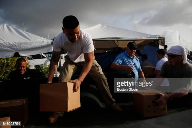 Volunteers unload a pick up truck full of supplies headed for St Thomas and St John in Fajardo Puerto Rico on Sep 12 2017 Volunteers were on the...