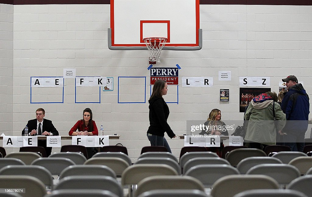 Volunteers wait as voters begin to arrive at the Ankeny 9 Republican caucus on January 3 2012 in Ankeny Iowa Iowans are preparing to caucus to vote...