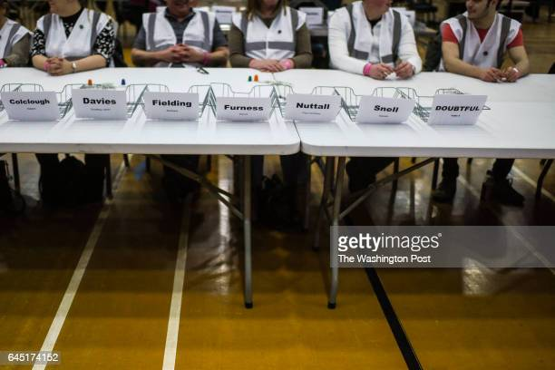 Volunteers wait for ballots to arrive during a byelection in Stoke on Trent United Kingdom on February 23 2016 The populist right wing UKIP party...
