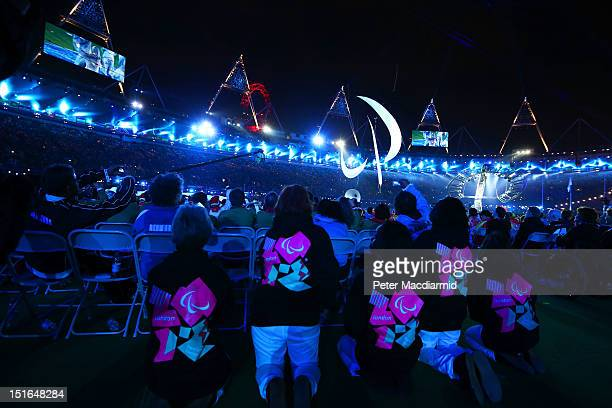 Volunteers watch the closing ceremony on day 11 of the London 2012 Paralympic Games at Olympic Stadium on September 9 2012 in London England