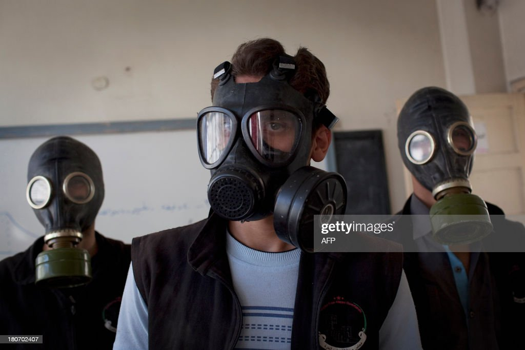 Volunteers wear gas masks during a class on how to respond to a chemical attack, in the northern Syrian city of Aleppo on September 15, 2013. For two months, Mohammad Zayed, an Aleppo University student, has been training a group of 26 civilians in the hope they can respond to a chemical attack.