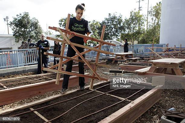 Volunteers with Enrich LA and the Los Angeles Kings work to build an edible and interactive garden at 20th Street Elementary School on January 24...