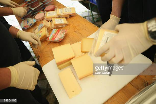 Volunteers with the Johanniter charity prepare cheese and ham for evacuees who had been forced to flee the rising floodwaters of the Weisse Elster...