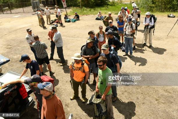 Volunteers with Trout Unlimited wait to pick up fish to carry in backpacks at the Herman Gulch trailhead on July 17 2017 in Clear Creek County near...