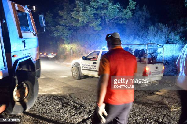 SILA LONGOBUCCO CALABRIA ITALY Volunteers work to extinguish a vast fire in Sila with fire trucks in Calabria southern Italy