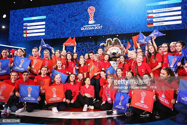 Volunters pose with Zabivaka the Official Mascot for the 2018 FIFA World Cup Russia after the Official Draw for the FIFA Confederations Cup Russia...