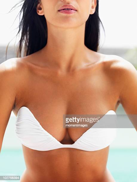 Voluptuous woman wearing strapless bikini top