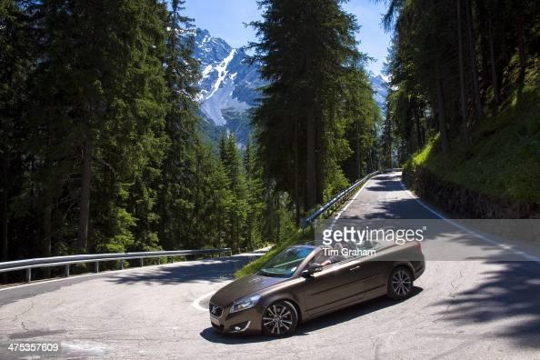 Volvo cabriolet sports car on The Stelvio Pass Passo dello Stelvio Stilfser Joch route to Trafio in The Alps Italy