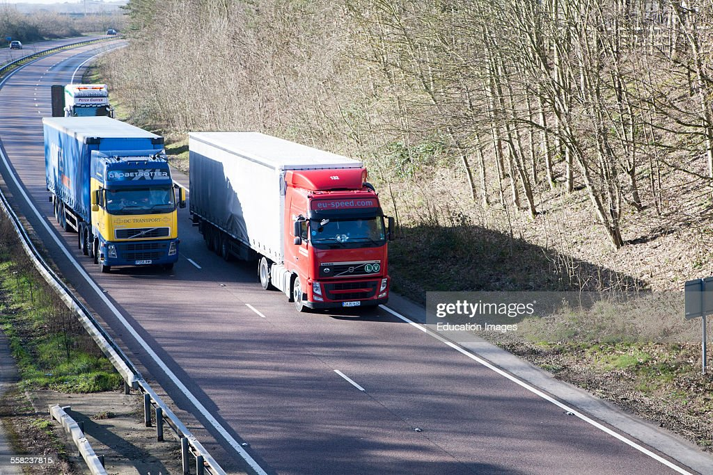 Volvo heavy goods vehicles on A12 trunk road in Suffolk England