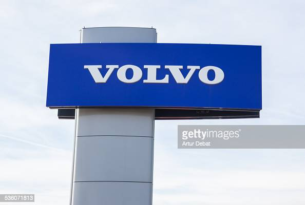 Volvo logo trademark on car distributor with sky