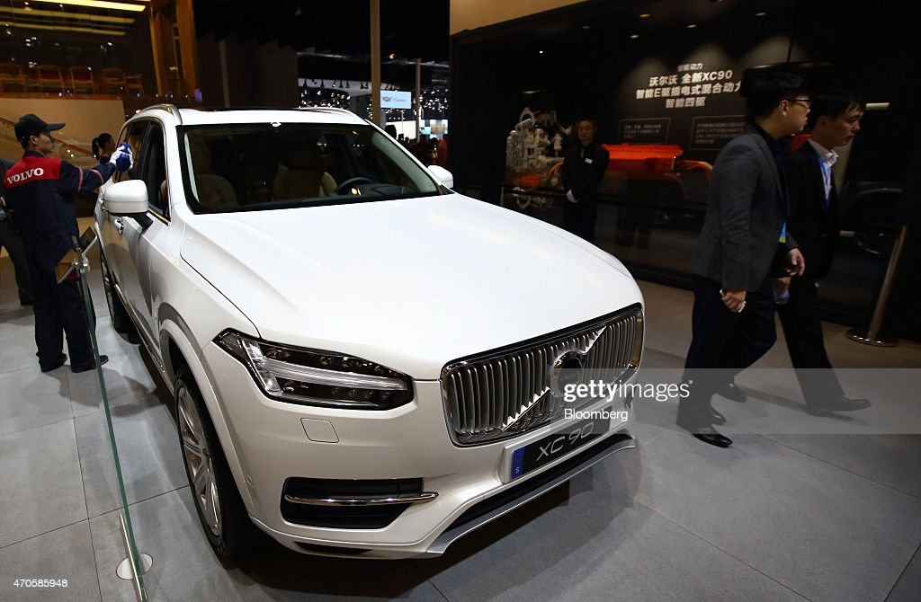 Volvo Exhibition Stand : A volvo xc vehicle produced by cars stands on