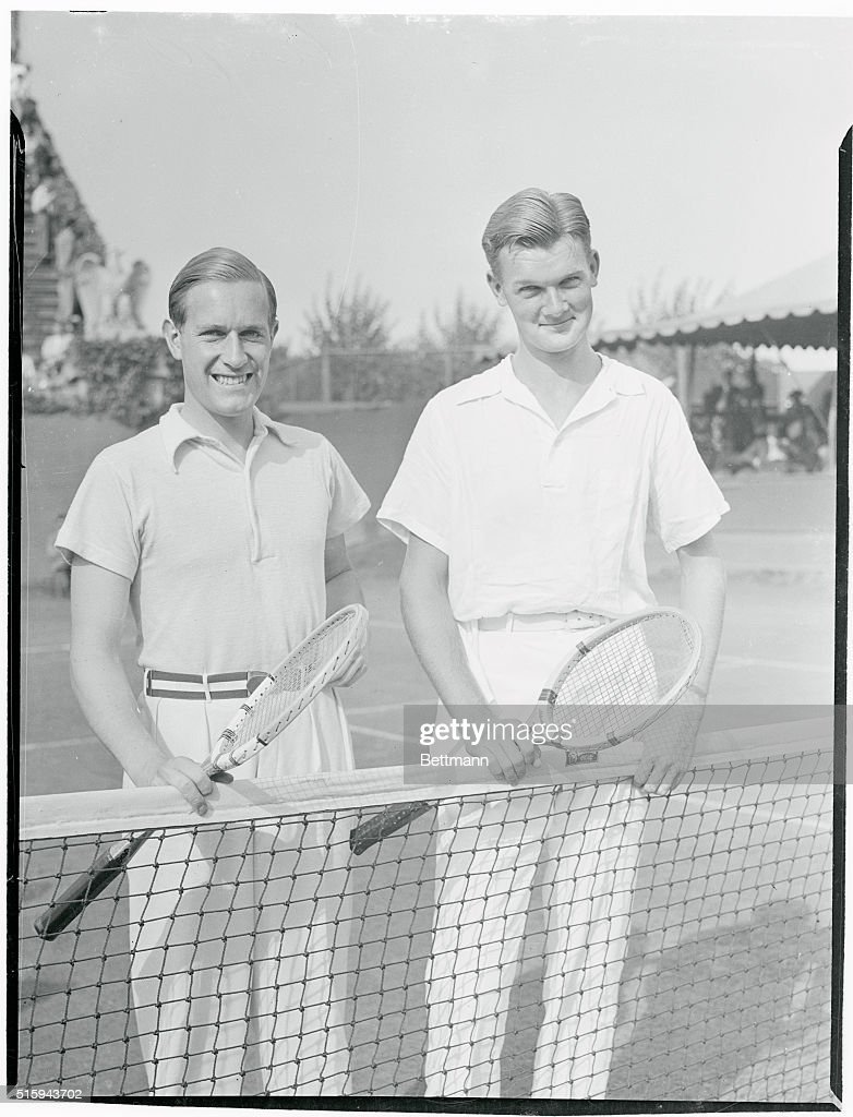 Tennis Players Posing at Net