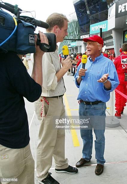 GP von Malaysia 2003 Kuala Lumpur Moderator Florian KOENIG/RTL Niki LAUDA