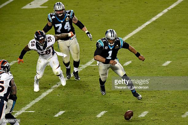 Von Miller of the Denver Broncos and Cam Newton of the Carolina Panthers attempt to recover a loose ball during the fourth quarter of Super Bowl 50...