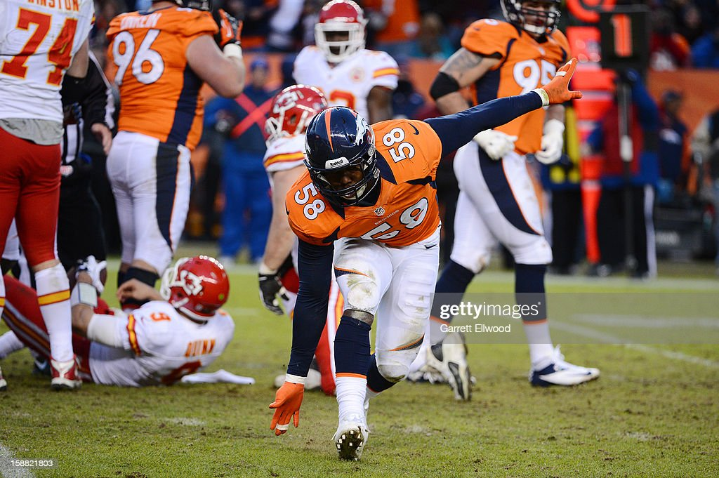 Von Miller #58 of the Denver Broncos celebrates his sack of Brady Quinn #9 of the Kansas City Chiefs during the game at Sports Authority Field at Mile High on December 30, 2012 in Denver, Colorado.
