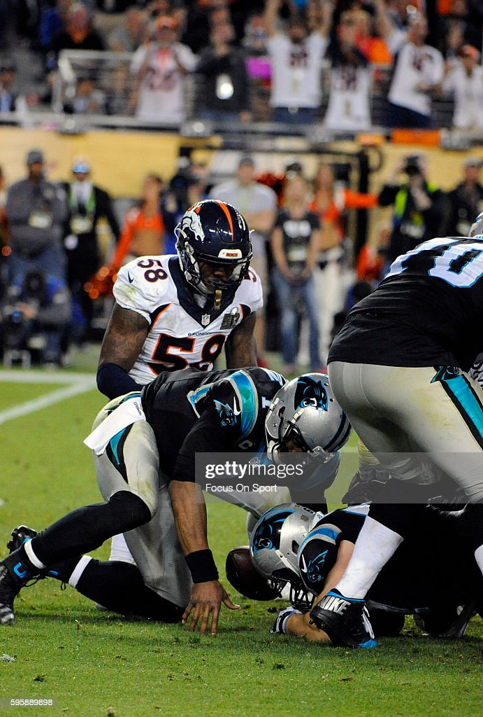 Von Miller of the Denver Broncos forces a fumble by quarterback Cam Newton of the Carolina Panthers during Super Bowl 50 at Levi's Stadium on...