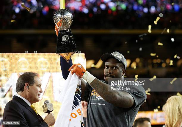 Von Miller of the Denver Broncos holds up the Vince Lombardi Trophy after defeating the Carolina Panthers during Super Bowl 50 at Levi's Stadium on...