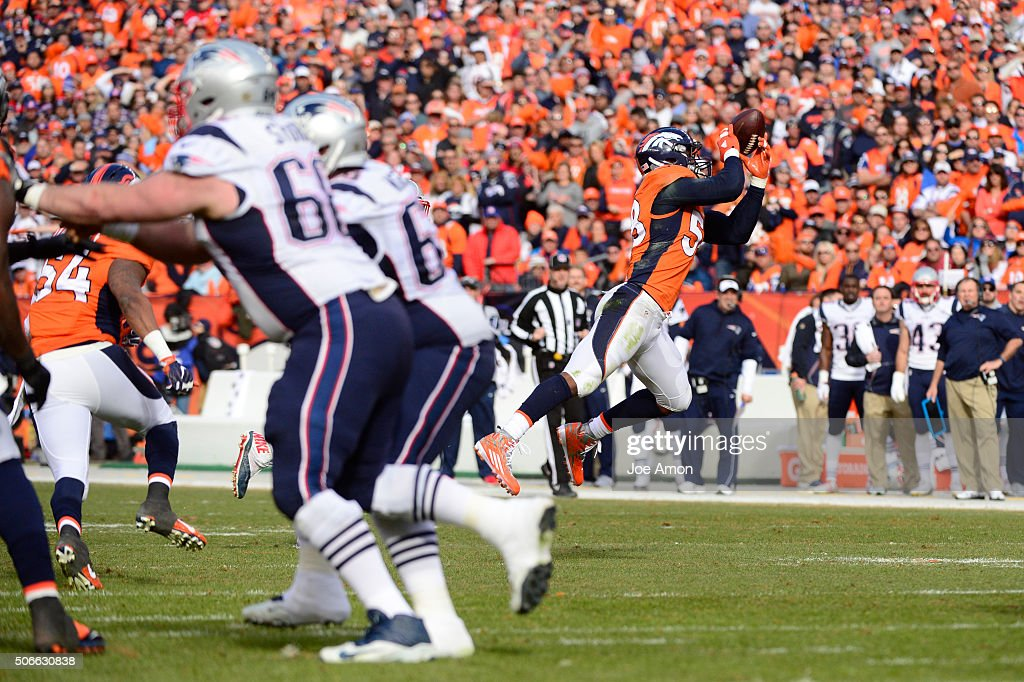 Von Miller of the Denver Broncos intercepts a pass in the second quarter The Denver Broncos played the New England Patriots in the AFC championship...