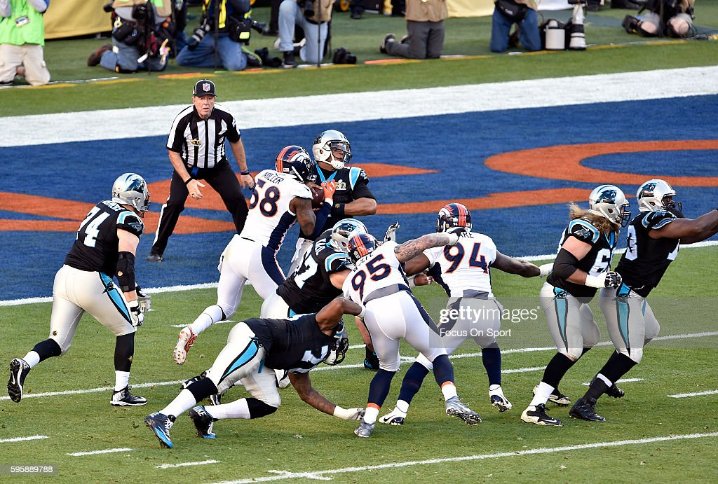 Von Miller of the Denver Broncos rushes quarterback Cam Newton of the Carolina Panthers and strips the ball away from him during Super Bowl 50 at...