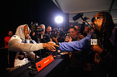 Von Miller of the Denver Broncos speaks to the media inlcuding Snoop Dogg during the Broncos media availability for Super Bowl 50 at the Stanford...
