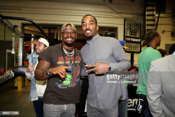 Von Miller of the Denver Nuggets poses with JR Smith of the Cleveland Cavaliers after the game against the Golden State Warriors in Game Four of the...