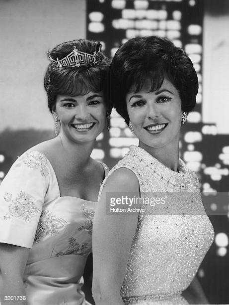 Vonda Kay Van Dyke Miss America 1965 wearing a tiara and Bess Myerson Miss America 1945 pose side by side in a promotional portrait for the CBS...