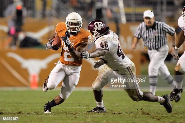 Vondrell McGee of the Texas Longhorns carries the ball against Matt Featherston of the Texas AM Aggies on November 27 2008 at Darrell K RoyalTexas...