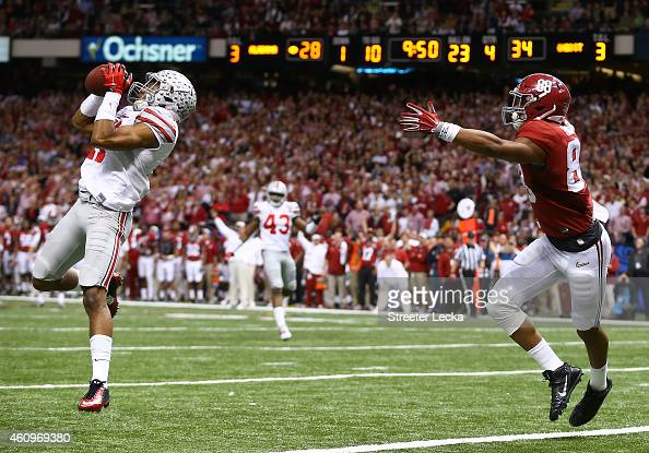 Vonn Bell of the Ohio State Buckeyes intercepts a ball in the fourth quarter thrown by Blake Sims of the Alabama Crimson Tide during the All State...