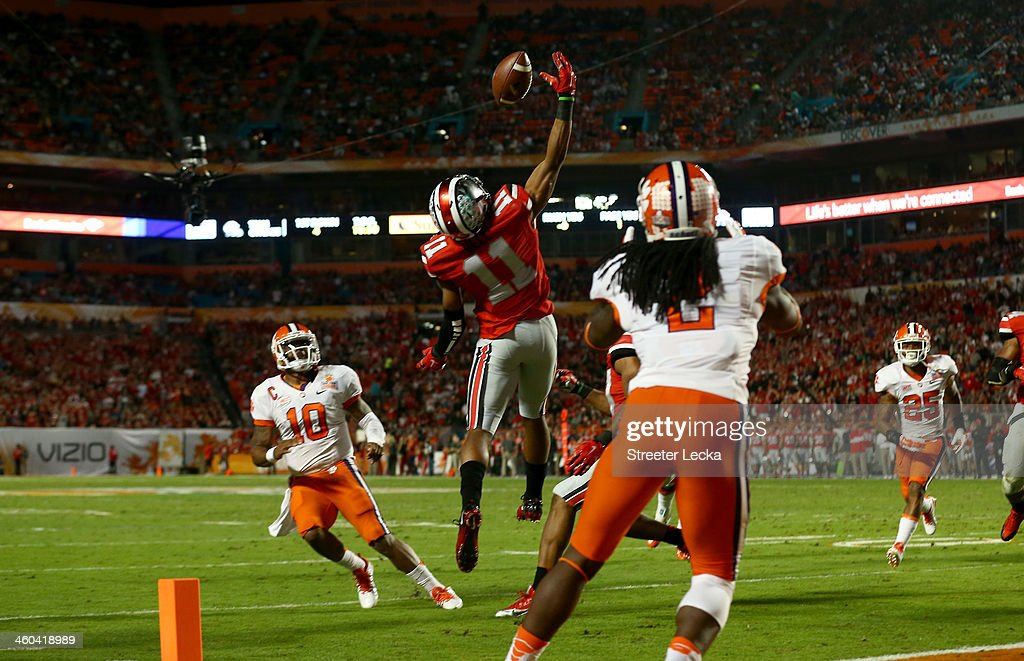 Vonn Bell #11 of the Ohio State Buckeyes intercepts a pass thrown by <a gi-track='captionPersonalityLinkClicked' href=/galleries/search?phrase=Tajh+Boyd&family=editorial&specificpeople=7352415 ng-click='$event.stopPropagation()'>Tajh Boyd</a> #10 of the Clemson Tigers in the second quarter during the Discover Orange Bowl at Sun Life Stadium on January 3, 2014 in Miami Gardens, Florida.