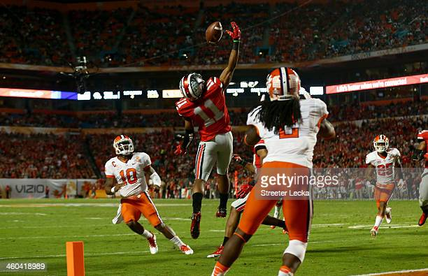 Vonn Bell of the Ohio State Buckeyes intercepts a pass thrown by Tajh Boyd of the Clemson Tigers in the second quarter during the Discover Orange...