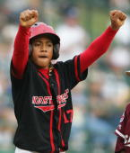Vonn Fe'ao of the Northwest celebrates after he making it to third base in the sixth inning during the Championship Game of the Little League World...