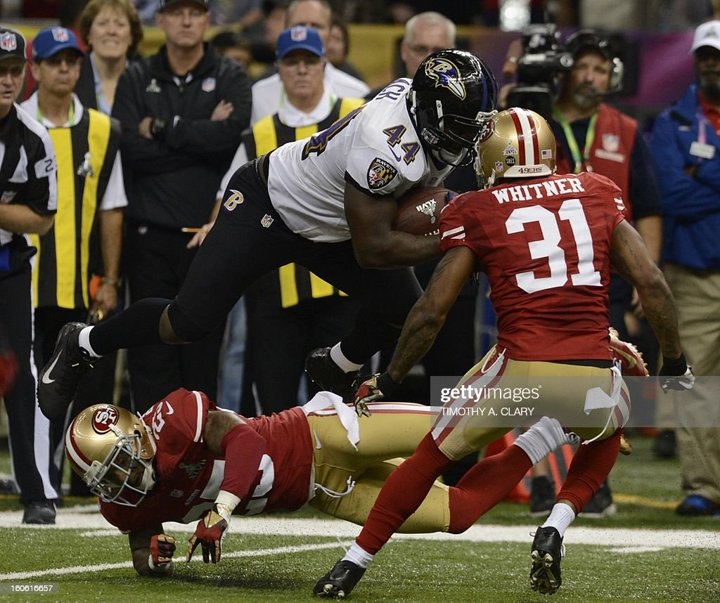 Vonta Leach (C) of the Baltimore Ravens moves the ball before Tarell Brown (L) and Donte Whitner (R) of the San Francisco 49ers during Super Bowl XLVII at the Mercedes-Benz Superdome on February 3, 2013 in New Orleans, Louisiana.