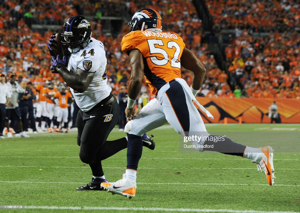 Vonta Leach of the Baltimore Ravens runs into the end zone for a touchdown after catching a pass in front of Wesley Woodyard of the Denver Broncos in...